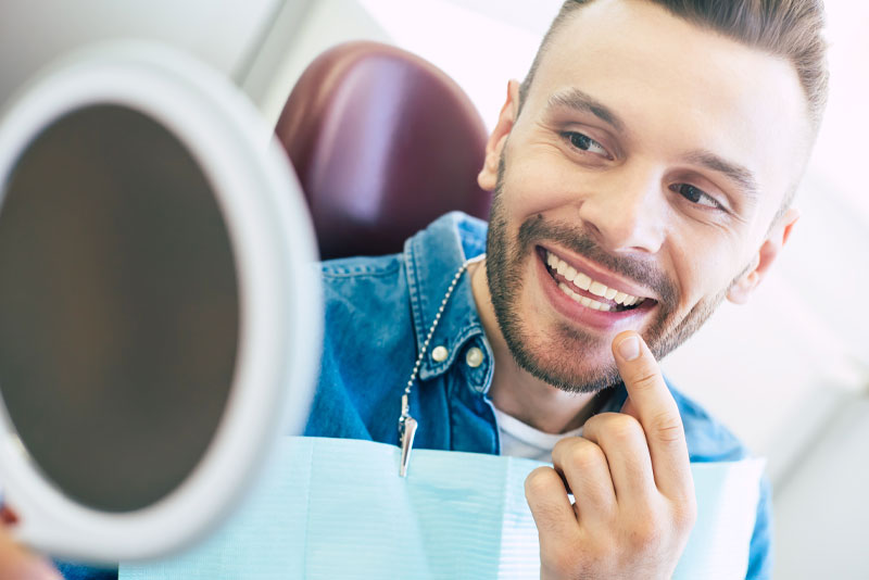 Dental Patient Smiling After Cosmetic Dentistry Procedures
